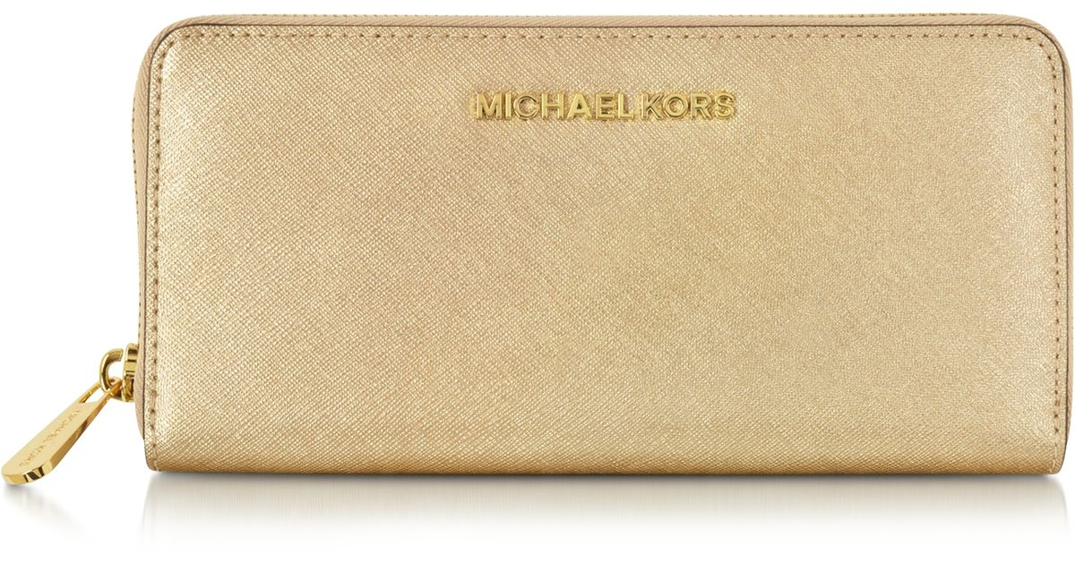 479133b61253 Michael Kors Jet Set Travel Pale Gold Saffiano Leather Continental Wallet  in Metallic - Lyst