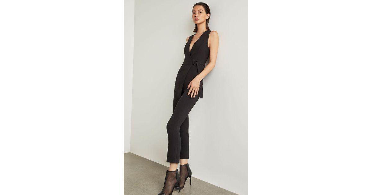 77d693554c3 Lyst - BCBGMAXAZRIA Bcbg Wrap-front Jumpsuit in Black