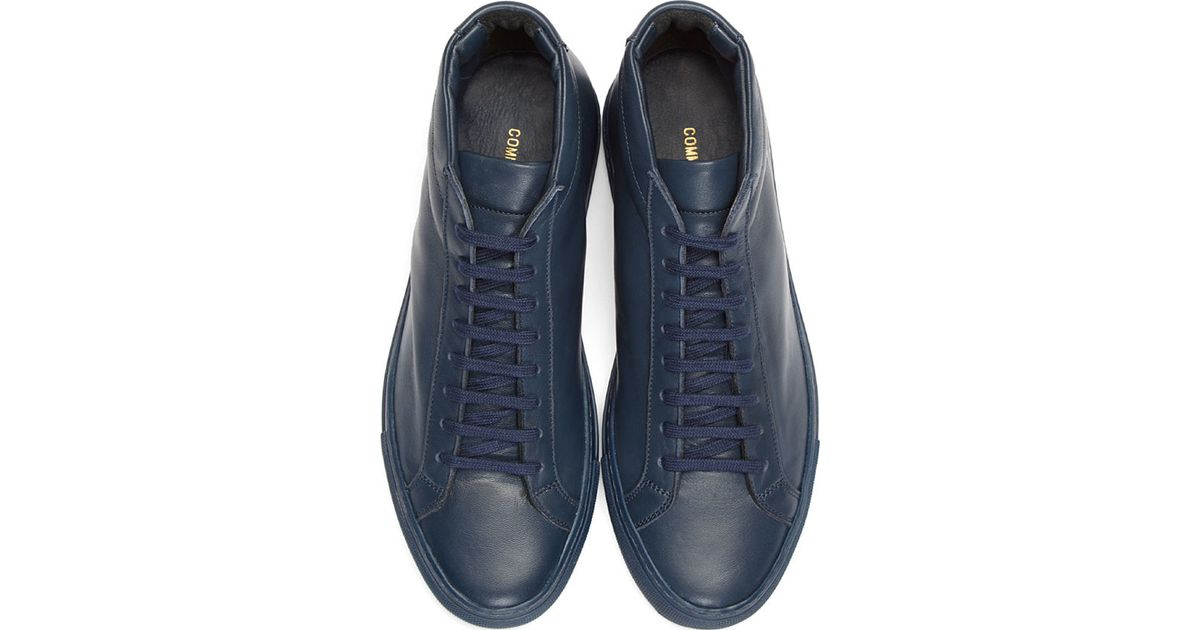 42658fa9fee11 Lyst - Common Projects Navy Leather Original Achilles Mid top Sneakers in  Blue for Men