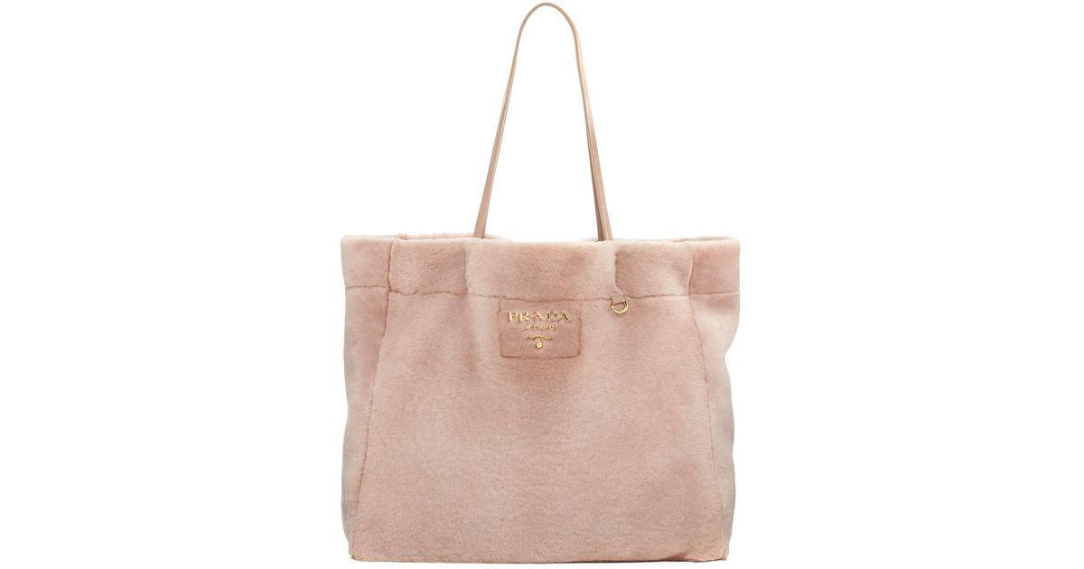b4b45364a245 Prada Medium East-west Shearling Fur Tote Bag in Pink - Lyst