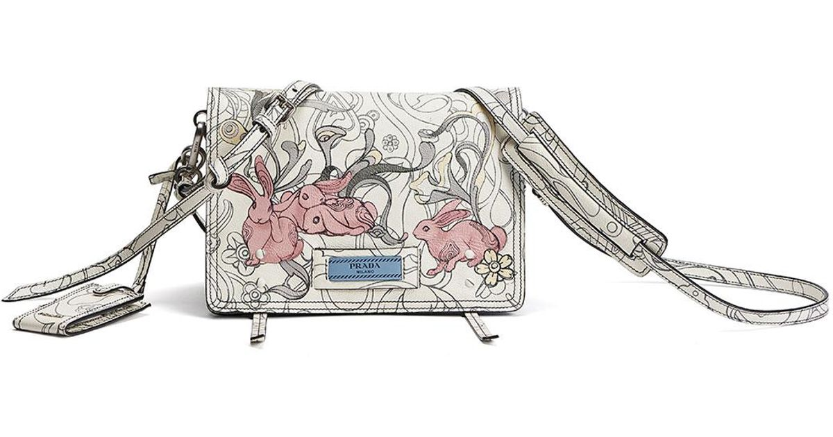 d194bf005147 ... clearance lyst prada etiquette small rabbit print leather crossbody bag  in white 71afa 7d799