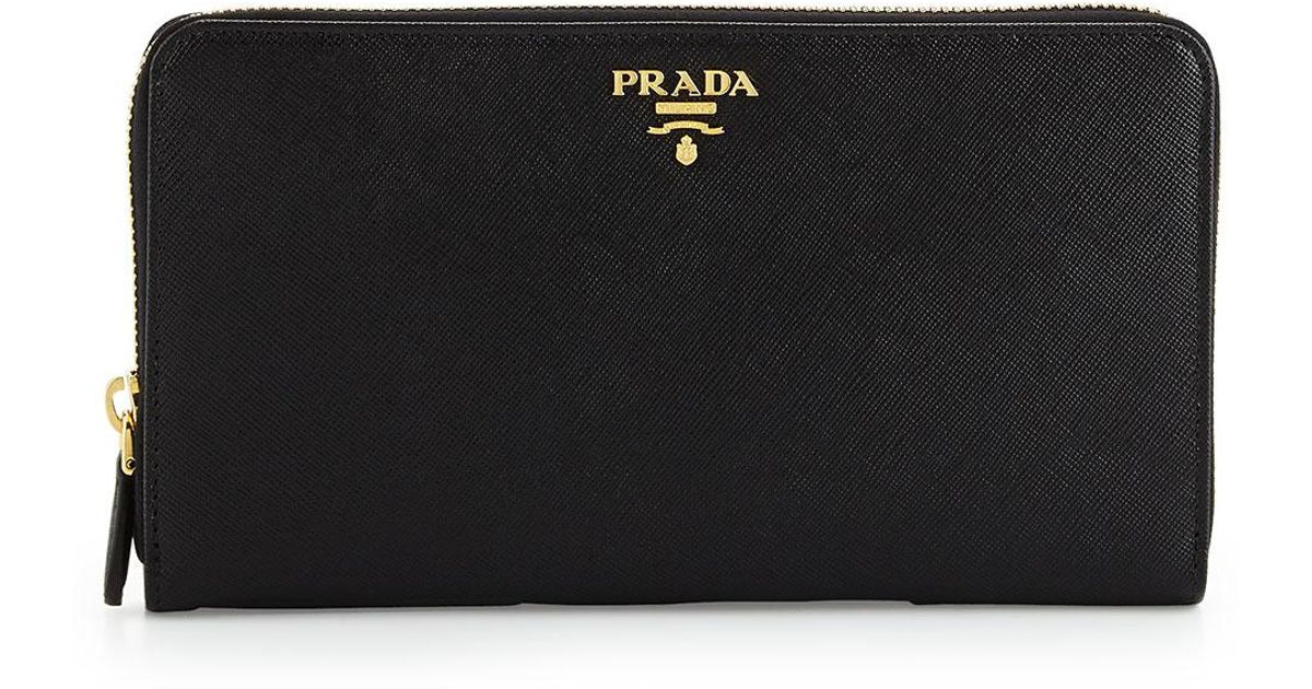 a5e126dfd00b Prada Textured Leather Travel Wallet in Black - Lyst