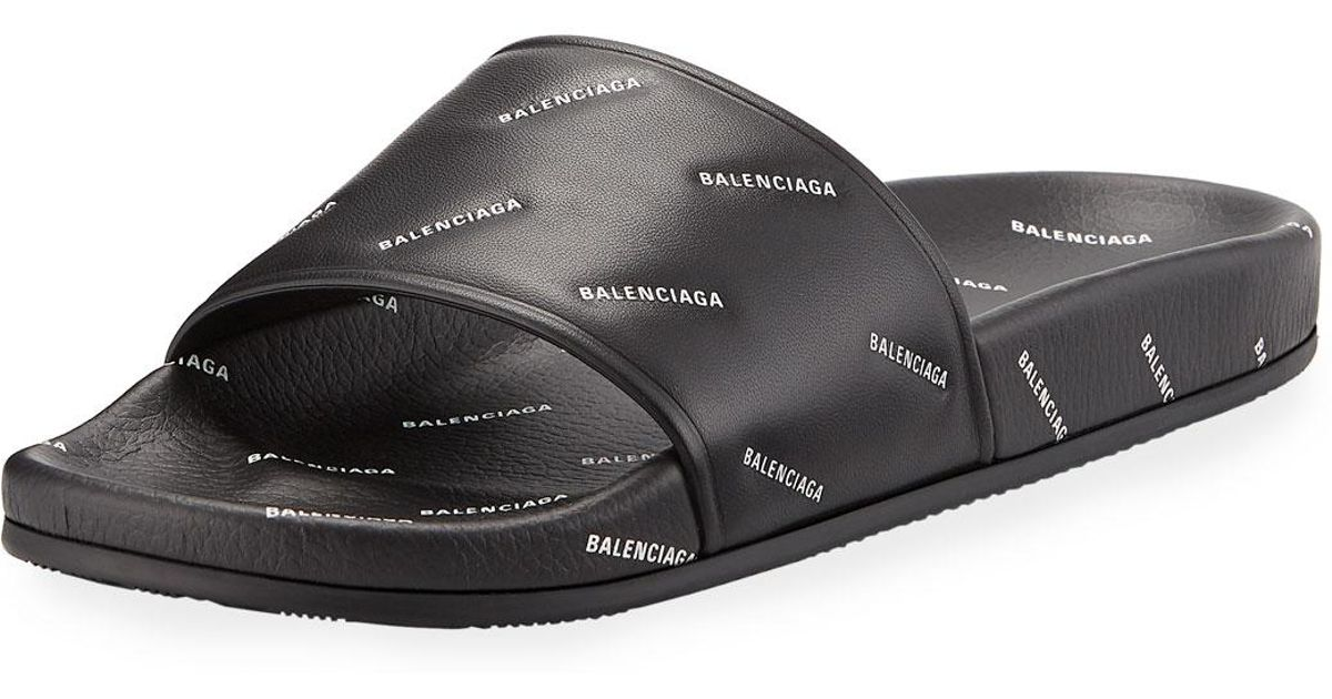 78a69f848ac8 Lyst - Balenciaga Logo Embossed Slides for Men - Save 47%