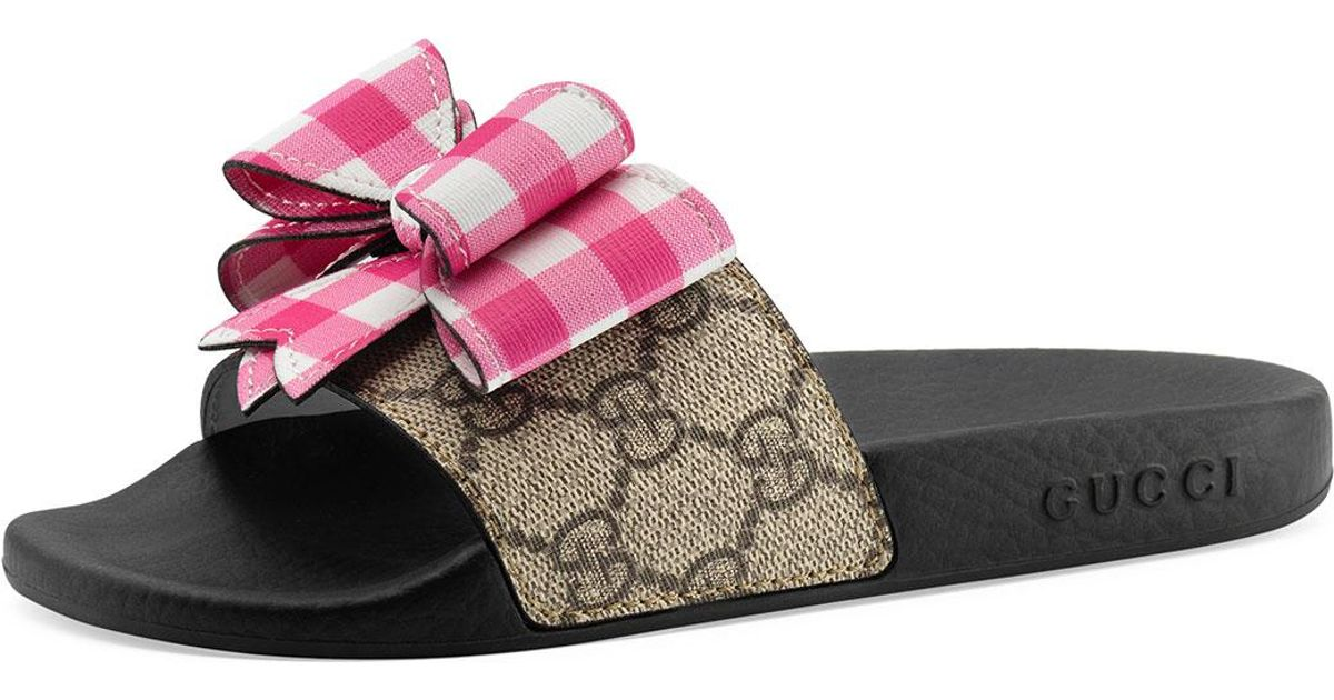 5a5f27b7f955 Lyst - Gucci Pursuit Gg Supreme Slide Sandal W  Bow in Natural