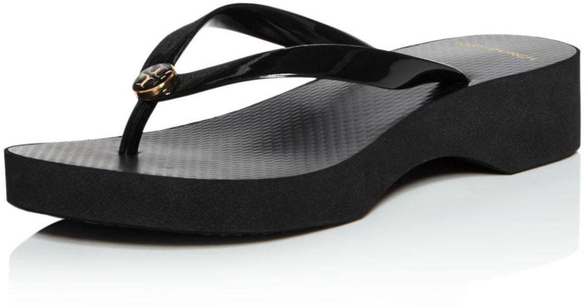 0fcd43f3f048 Lyst - Tory Burch Women s Cut-out Wedge Flip-flops in Black