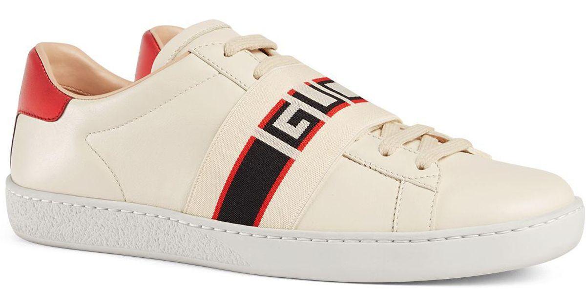 d1f670f3b391 Lyst - Gucci Women s Ace Leather Logo Stripe Sneakers in White