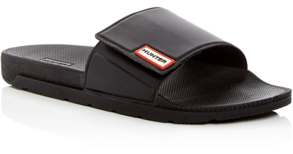 2228b4bb5c0 Lyst - HUNTER Women s Original Adjustable Slides in Black - Save 38%