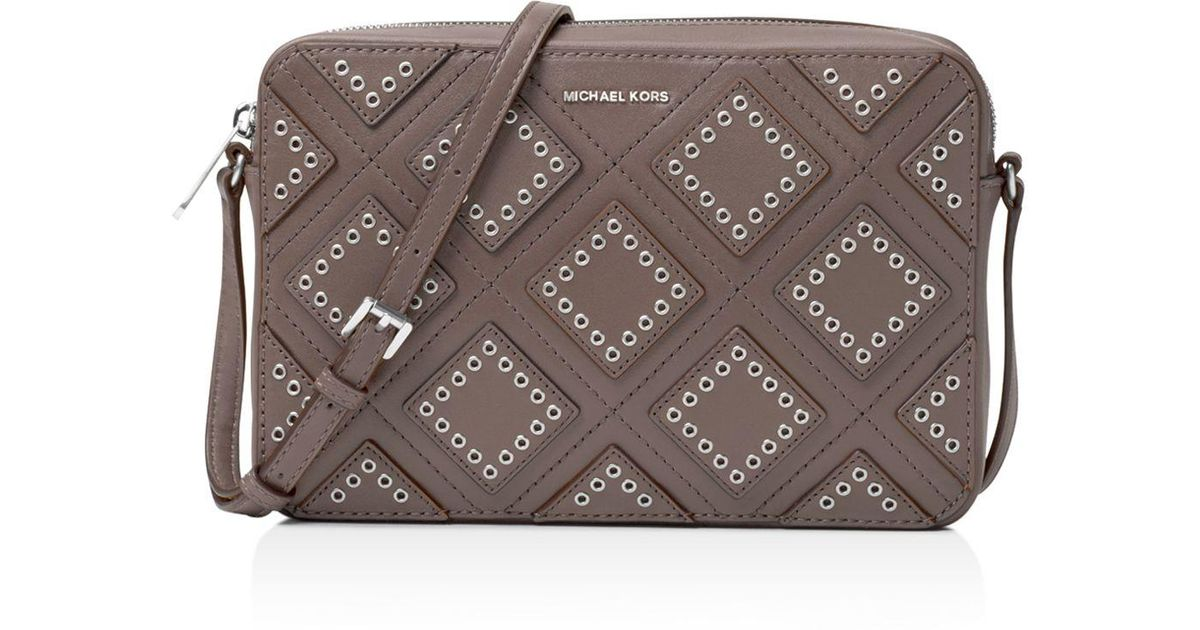 549c1f0ad64b Lyst - MICHAEL Michael Kors Jet Set Travel Large Diamond Grommet East west  Crossbody