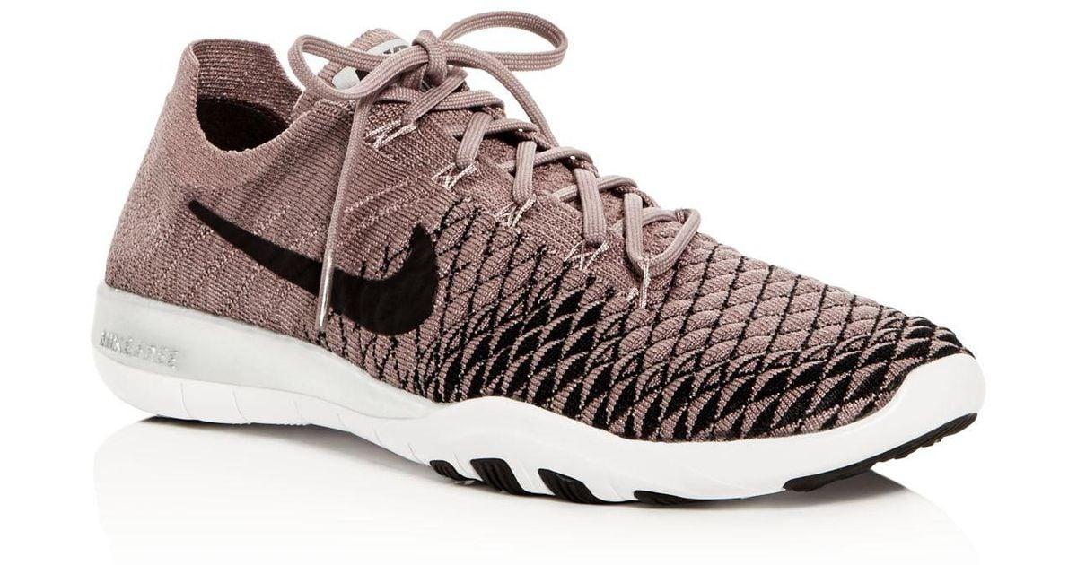 45f11ca31318 Lyst - Nike Women s Free Tr Flyknit 2 Bionic Lace Up Sneakers