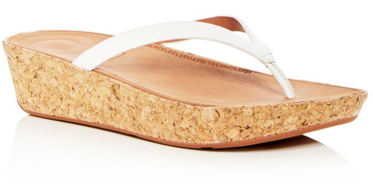289ad27b3e4e Lyst - Fitflop Women s Linny Leather Wedge Flip-flops
