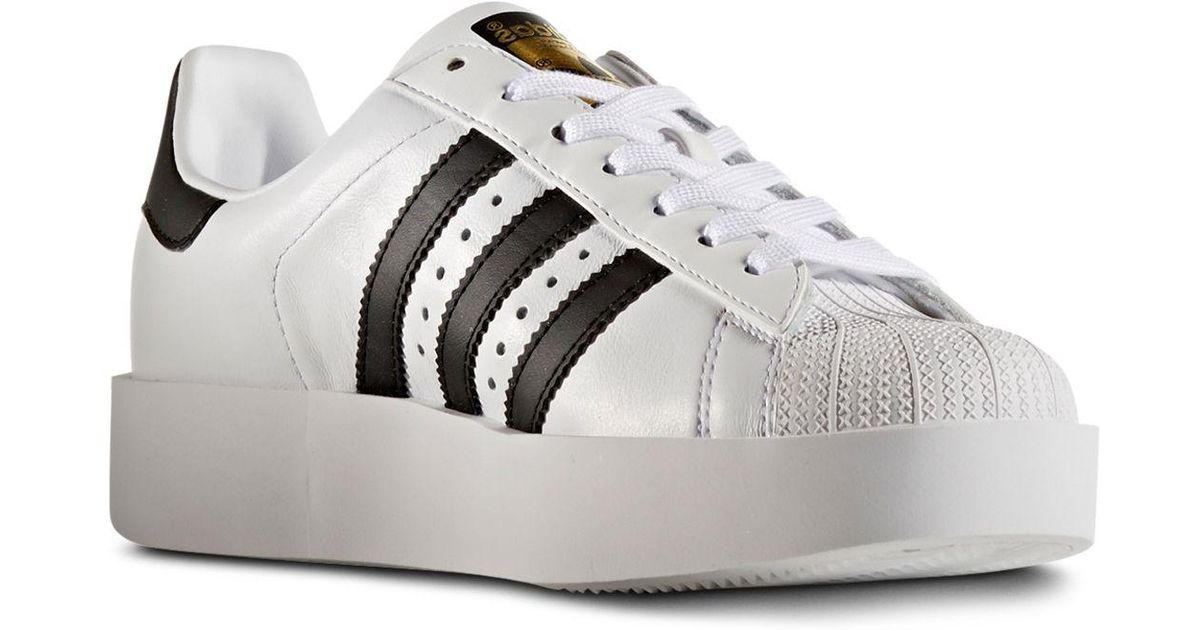 0f12dbcf61a1 Lyst - adidas Women s Superstar Bold Platform Lace Up Sneakers in White
