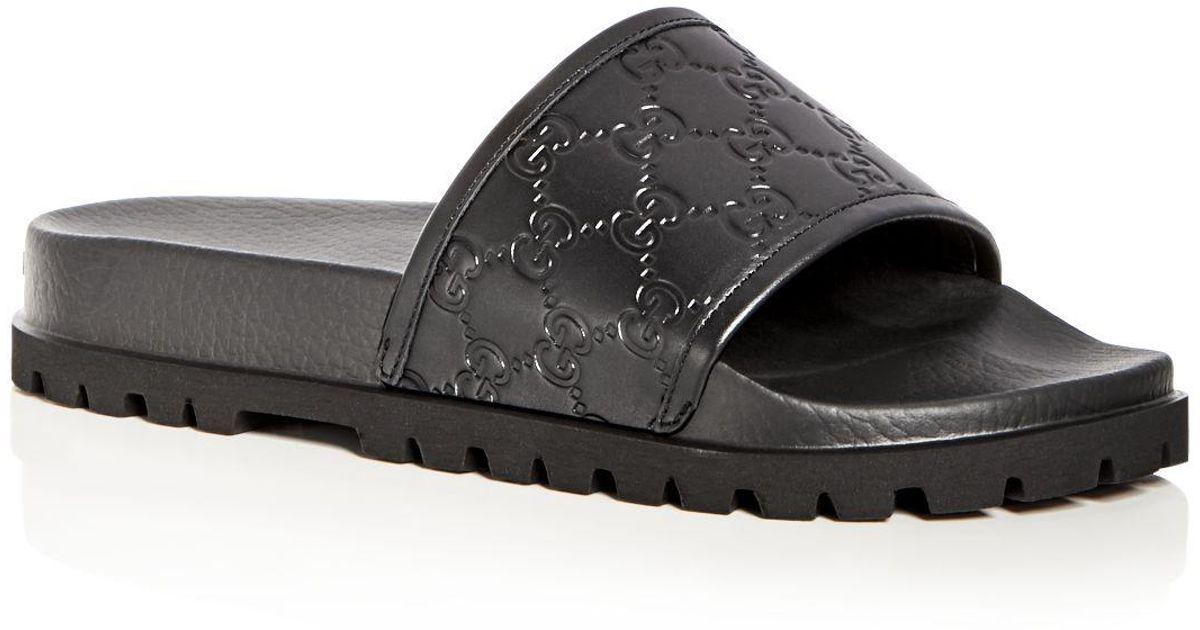 d3ea9fe63e3e Lyst - Gucci Men s Pursuit Treck Embossed Leather Slide Sandals in Black  for Men