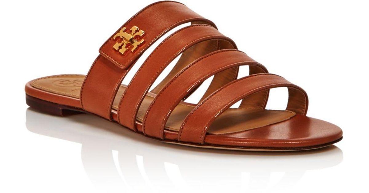 3fa067f9bf34 Lyst - Tory Burch Women s Kira Multi-band Slide Sandals in Brown
