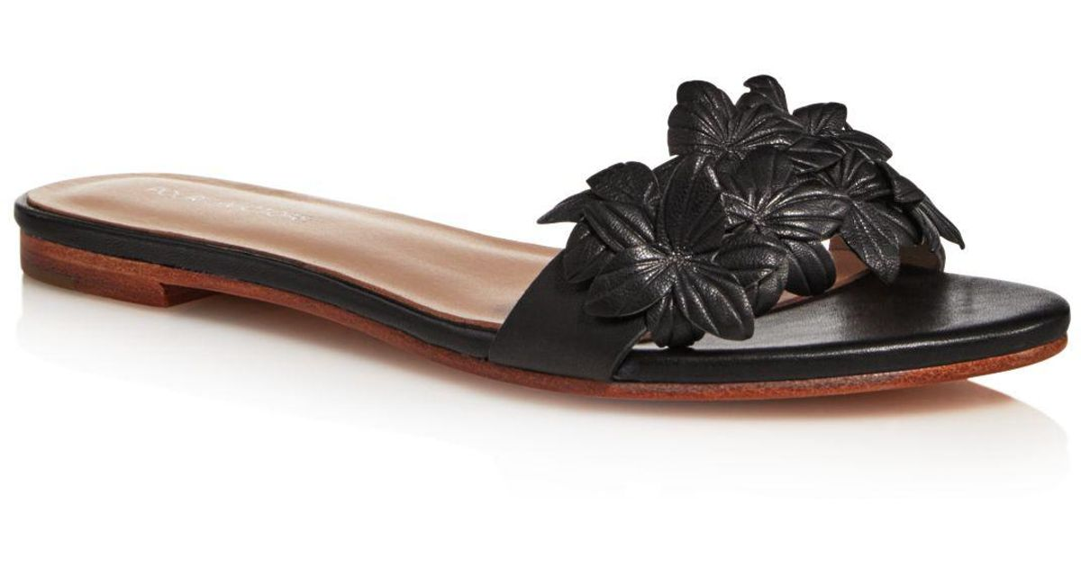 6e7660b3eac Pour La Victoire Lani Leather Floral Embellished Slide Sandals in Black -  Lyst
