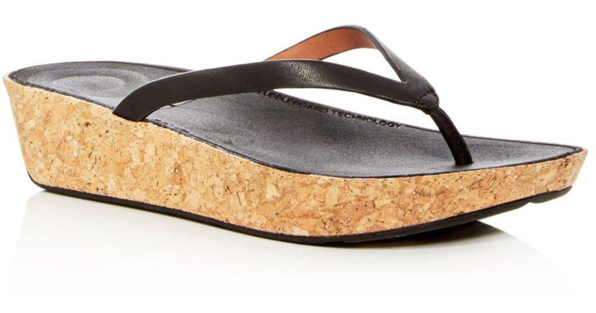 735ec1a7e1ed Lyst - Fitflop Women s Linny Leather Wedge Flip-flops in Black