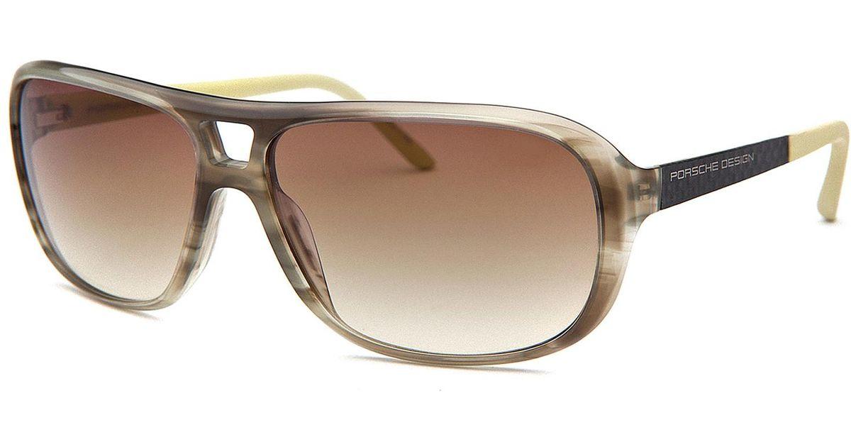 a3d288f02aa Lyst - Porsche Design Women s Aviator Striped Olive Green Sunglasses in  Natural