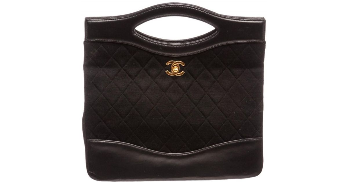 Lyst Chanel Pre Owned Black Quilted Fabric Leather Trim Bowling Satchel Handbag In