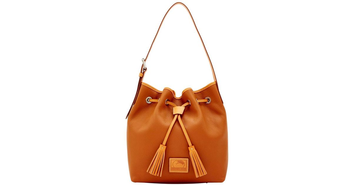 096e394bc6a4 Lyst - Dooney   Bourke Patterson Leather Aimee Drawstring Shoulder Bag in  Brown
