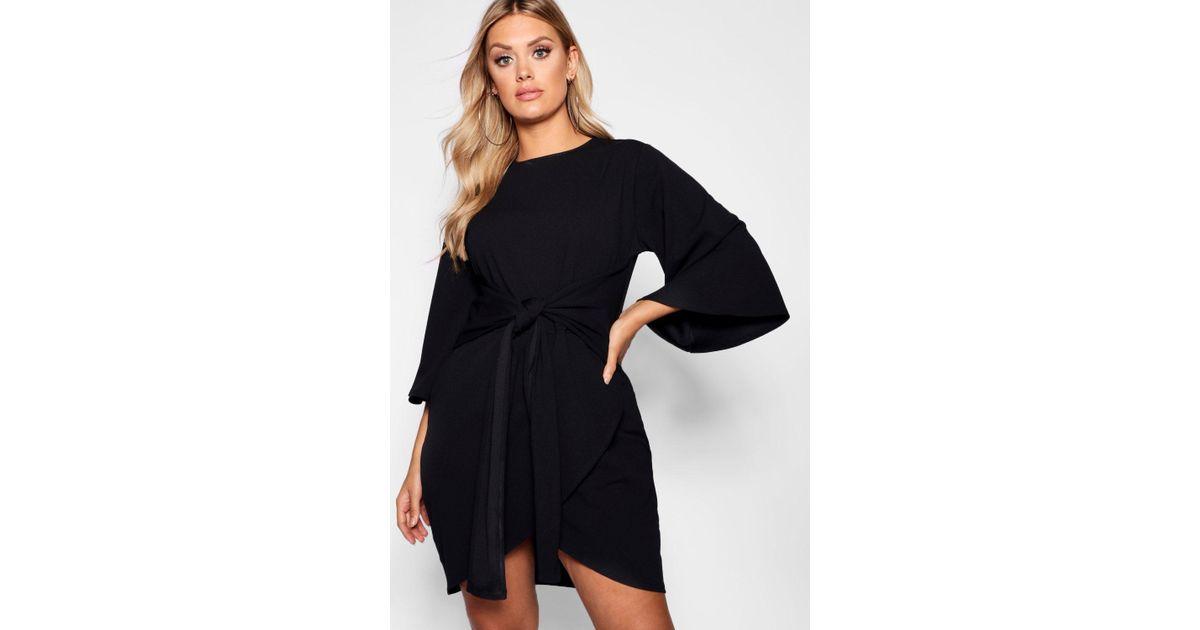 9bd31dd98b5f Boohoo Plus Kimono Sleeve Tie Waist Wrap Dress in Black - Lyst