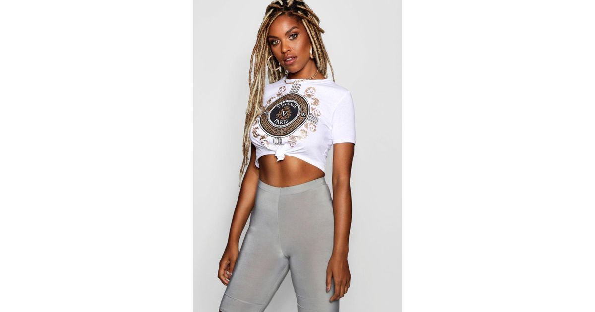 79e4bd84293b3 Lyst - Boohoo Isabella Vogue Foil Slogan Tie Front T-shirt in White