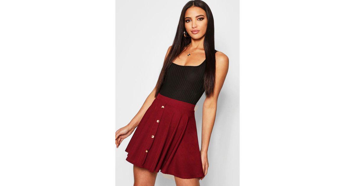 8511e621b57a Lyst - Boohoo Basic Button Front Ribbed Skater Mini Skirt
