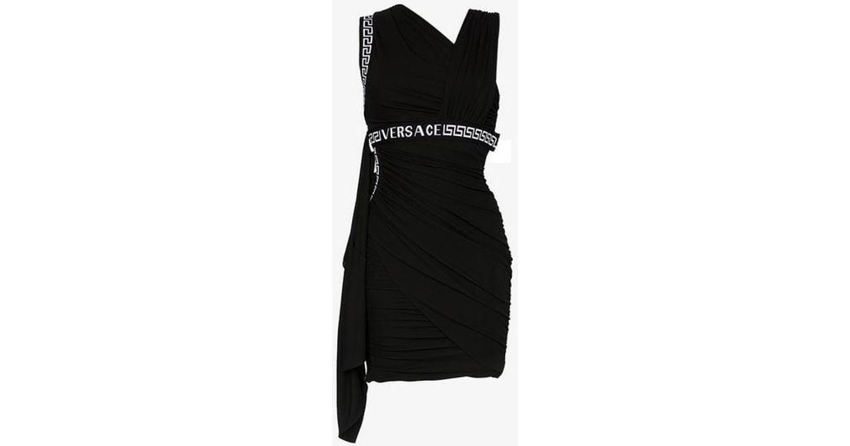 e7c7c440638a Versace Asymmetric Neck Logo Mini Dress in Black - Lyst