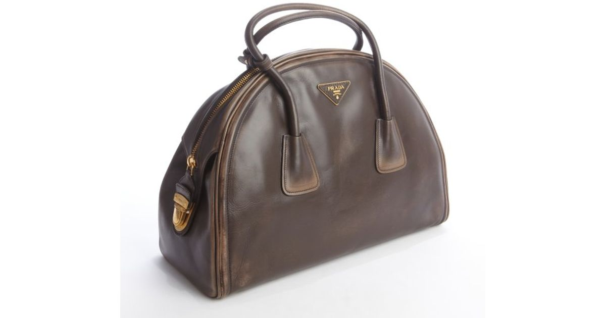 789244ffb3 ... low price lyst prada coffee distressed leather bowler bag in brown  95c76 9d5b7