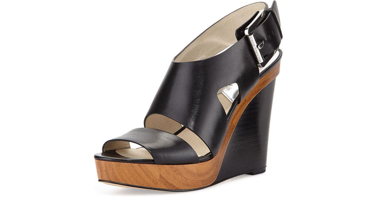 83913af9c4e Lyst - MICHAEL Michael Kors Carla Platform Wedge Sandals in Black