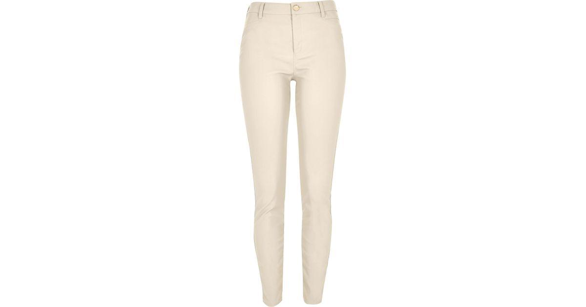 da25d25f810a4 River Island Cream Skinny Leather Look Trousers in Black - Lyst