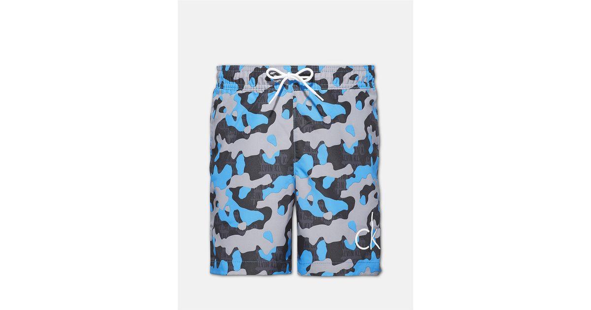 aae99532da Lyst - Calvin Klein Boys Ck Print Camo Logo Swim Shorts in Blue for Men