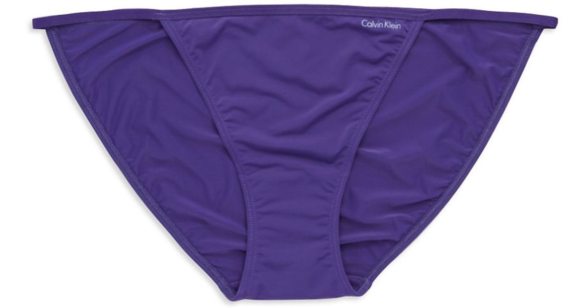 calvin klein string bikini brief in purple tidal purple. Black Bedroom Furniture Sets. Home Design Ideas