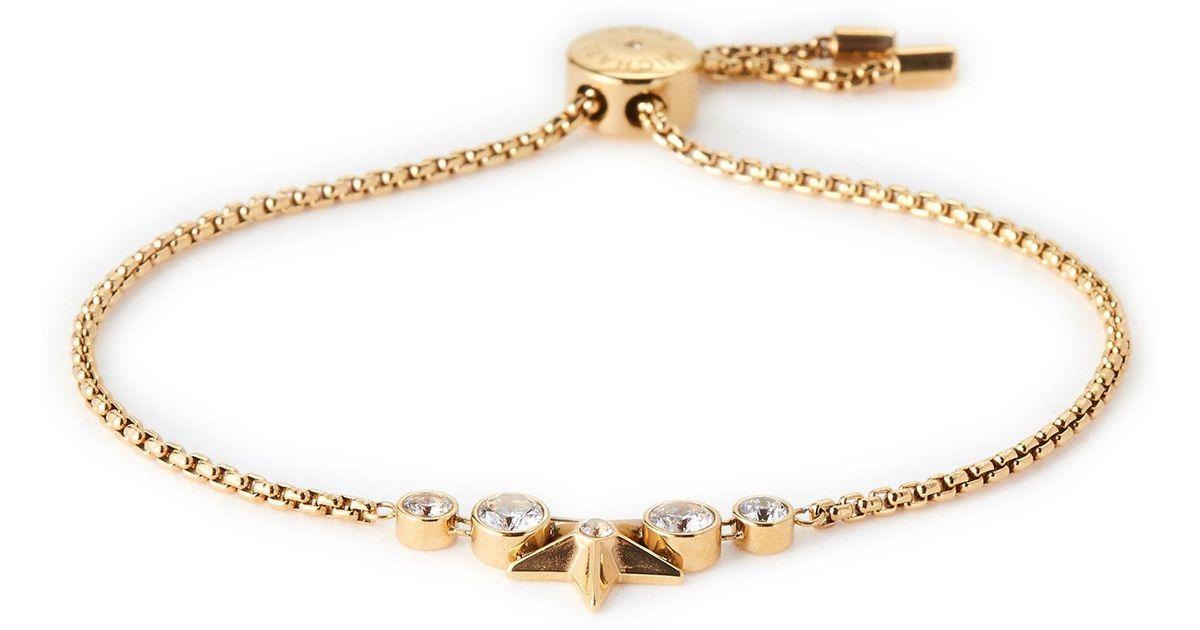 d93a37308582 Lyst - Michael Kors Gold-tone Celestial Star Slider Bracelet in Metallic
