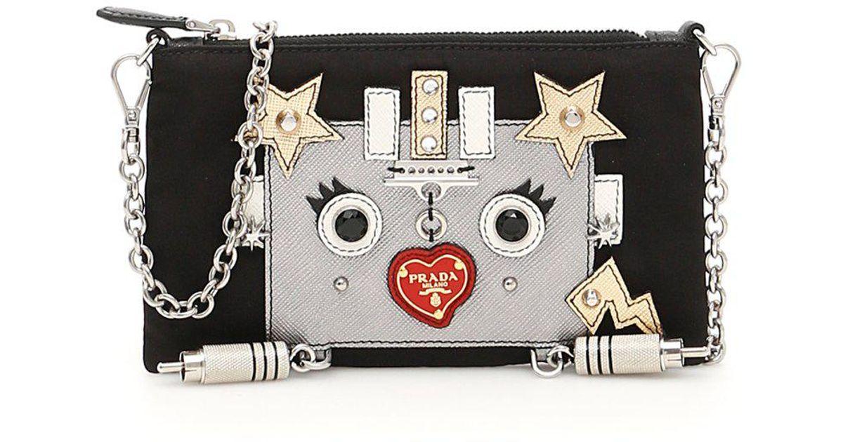 00025e2e999db5 Prada Robot Clutch Bag in Black - Lyst
