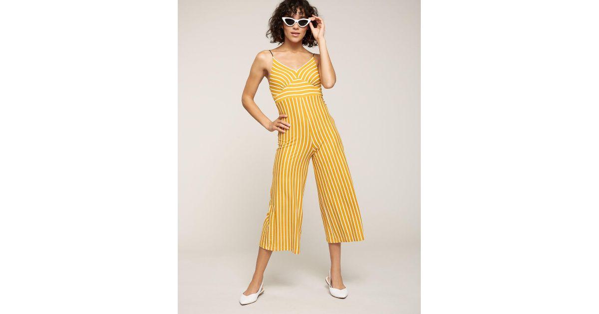 80b4eeb724c Lyst - Charlotte Russe Striped Culotte Leg Jumpsuit in Yellow