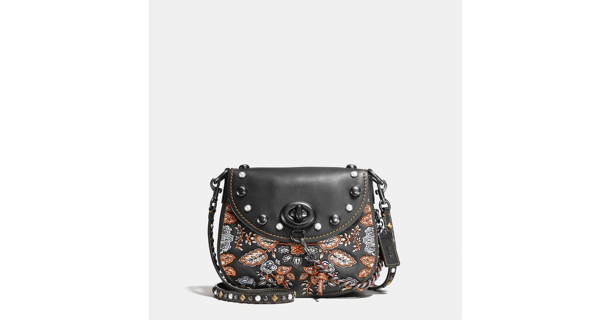 Lyst Coach Embellished Forest Flower Turnlock Saddle Bag 23 In Glovetanned Leather Black