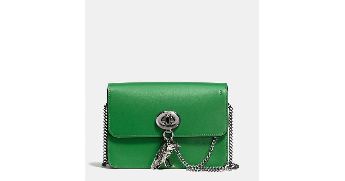 f775958b16 ... clearance lyst coach bowery crossbody in refined calf leather with  rebel charm in green 93bd1 1c7a6