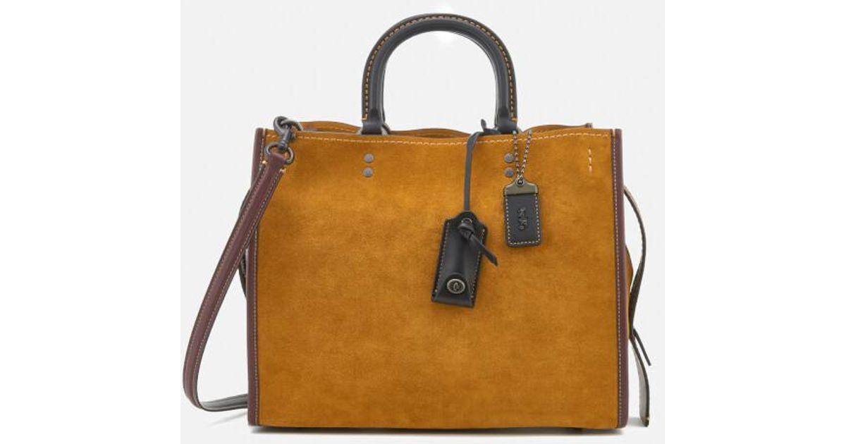52d44a70496a Lyst - COACH 1941 Women s Colourblock Suede Rogue Bag in Brown