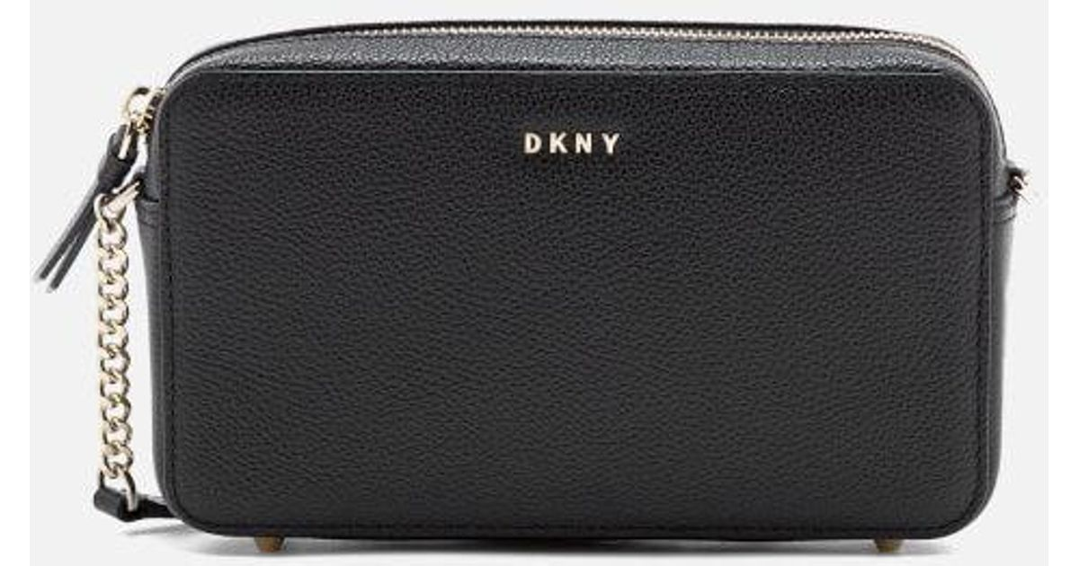 f95c57c229fd Lyst - DKNY Women s Chelsea Pebbled Small Leather Top Zip Cross Body Bag in  Black