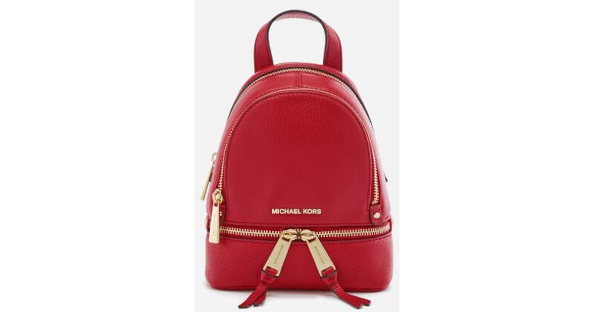 02c0feccfa39 ... shop lyst michael michael kors womens rhea zip extra small backpack in  red 22ebb d4099