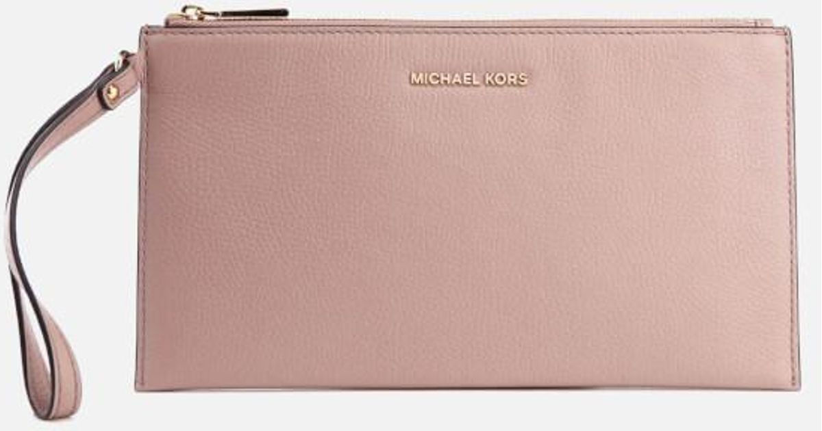 eacb225ad034 Lyst - MICHAEL Michael Kors Women s Mercer Zip Clutch Bag in Pink