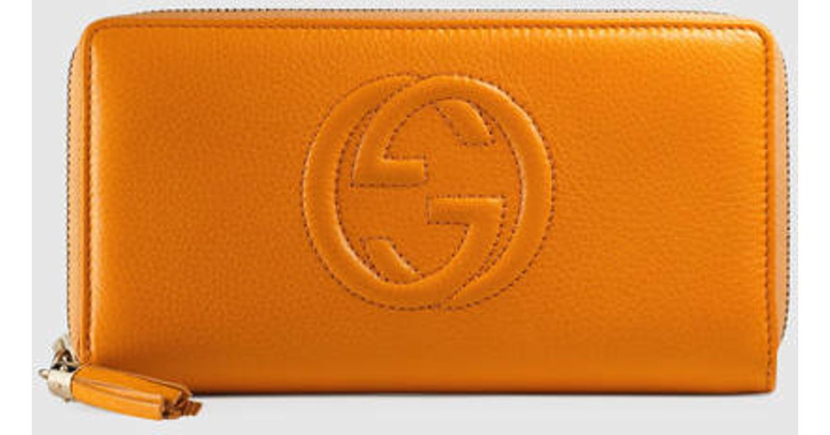 7aadea31991 Lyst - Gucci Soho Leather Zip Around Wallet in Orange