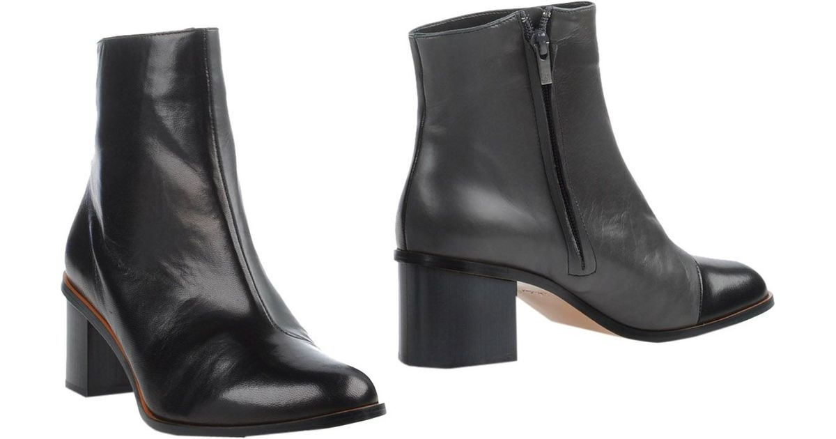 robert clergerie ankle boots in black save 66 lyst