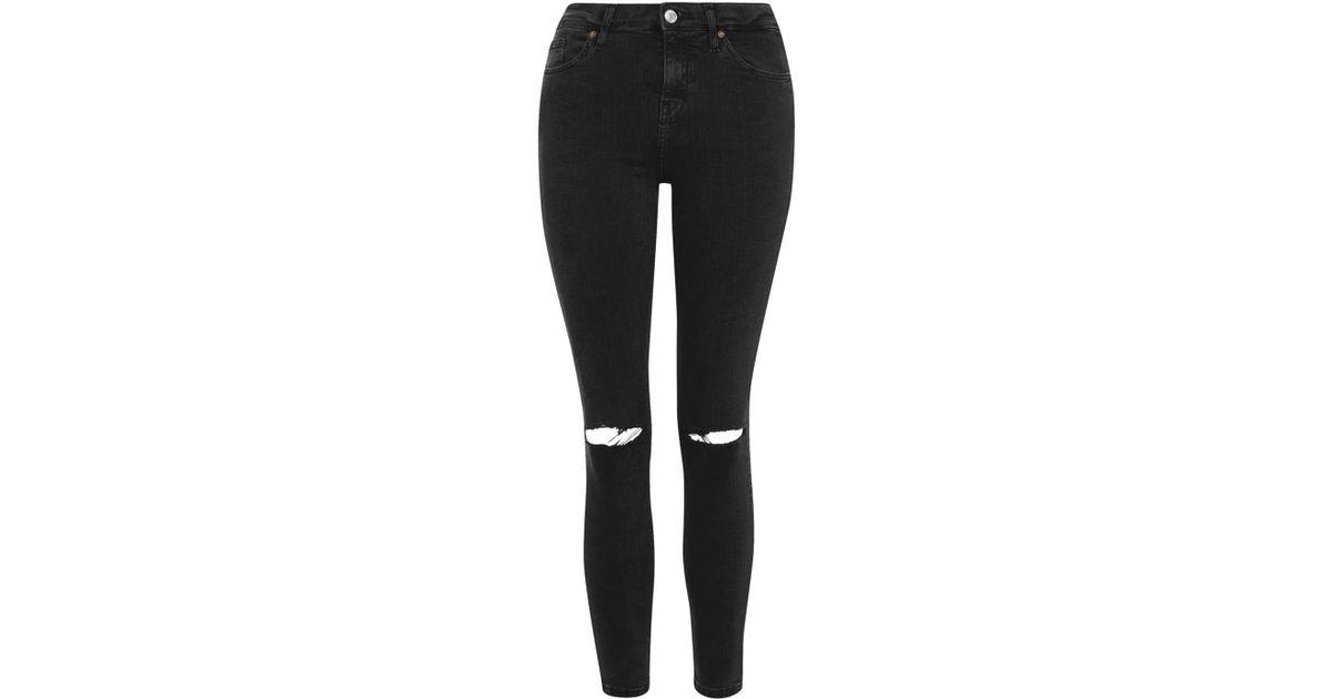 e83ecb00e7f8 Lyst - TOPSHOP Petite Rip Jamie Jeans in Black