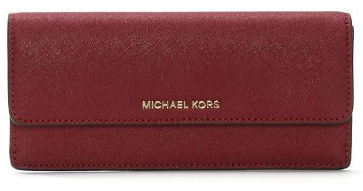 dd2ed51807df Michael Kors Jet Set Travel Mulberry Saffiano Leather Slim Wallet in Red -  Lyst