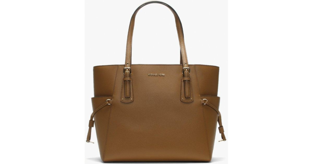 4e12cf3cf86a Michael Kors Voyager East West Acorn Saffiano Leather Tote Bag in Brown -  Lyst