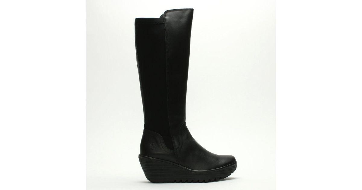 cb6920d3def9 Lyst - Fly London Yeve Black Leather Stretch Back Wedge Knee Boots in Black