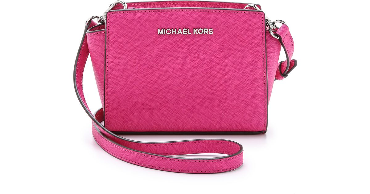 65ae9e51c473c ... promo code for michael michael kors selma mini messenger bag blossom in pink  lyst 5c115 efa11