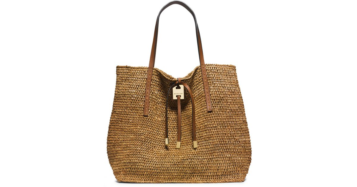 8ad2ed57b6f2 ... where can i buy lyst michael kors miranda large raffia tote in natural  84c11 bd358 ireland michael kors jaryn calf leather ...