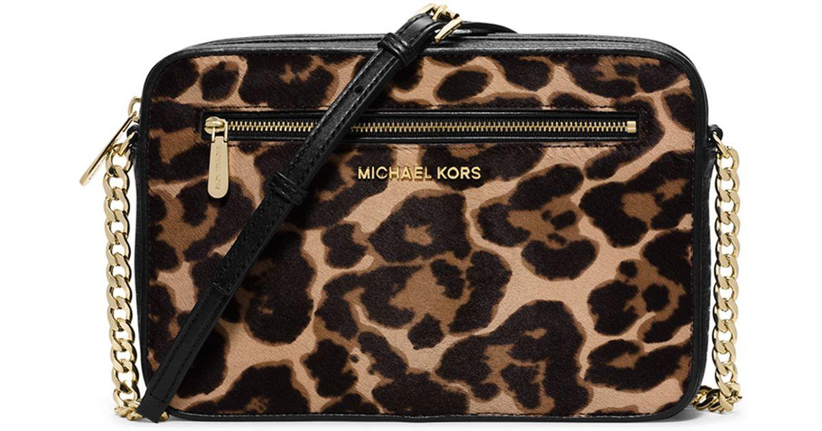 Lyst - MICHAEL Michael Kors Jet Set Large Cheetah-Print Cross-Body Bag in  Brown 02db929aff6df