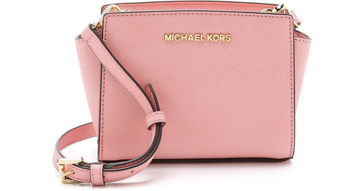 7f8166f0dc1d1 ... sale lyst michael michael kors selma mini messenger bag pale pink in  pink 00f1a b4658